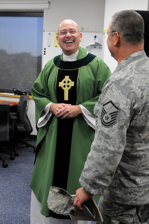 The newest chaplain at the 123rd Airlift Wing, Capt. Jeffrey Nicolas, speaks with an Airman following Catholic Mass at the Kentucky Air National Guard Base in Louisville, Ky., Oct. 18, 2015. Nicolas previously served as a chaplain in the U.S. Navy. (U.S. Air National Guard photo by Tech. Sgt. Vicky Spesard)