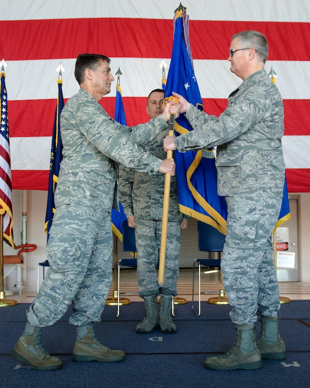 Col. David Mounkes (right), the new commander of the 123rd Airlift wing, accepts the wing guidon from Brig. Gen. Warren Hurst, Kentucky's assistant adjutant general for Air, during an assumption-of-command ceremony at the Kentucky Air National Guard Base in Louisville, Ky., on April 16, 2016. Mounkes most recently served as commander of the 123rd Contingency Response Group. (U.S. Air National Guard photo by Senior Airman Joshua Horton)