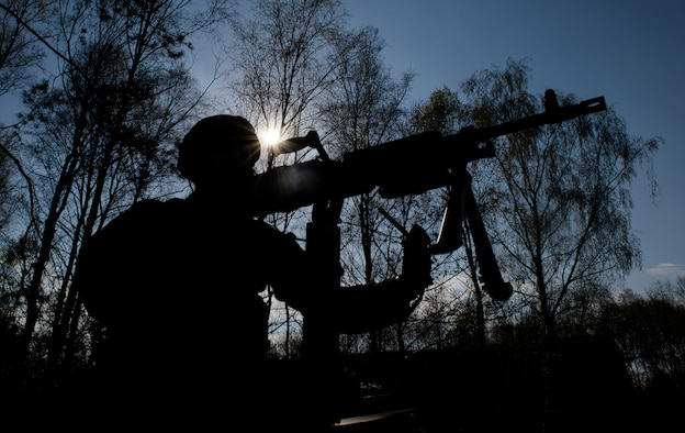 An instructor from the 435th Security Forces Squadron removes a weapon from a Humvee at Ramstein Air Base, Germany, April 11, 2016. The Airmen practiced for scenarios they might encounter during deployment. (U.S. Air Force photo/Staff Sgt. Armando A. Schwier-Morales)