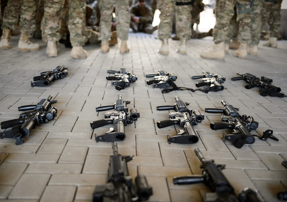 Weapons lay on the ground as Airmen wait for training to begin April 11, 2016 at Ramstein Air Base, Germany. The Airmen participated in a variety of tasks in order to prepare for an upcoming deployment where they would execute one of their primary missions of building a base from the ground up. (U.S. Air Force photo/Staff Sgt. Armando A. Schwier-Morales)