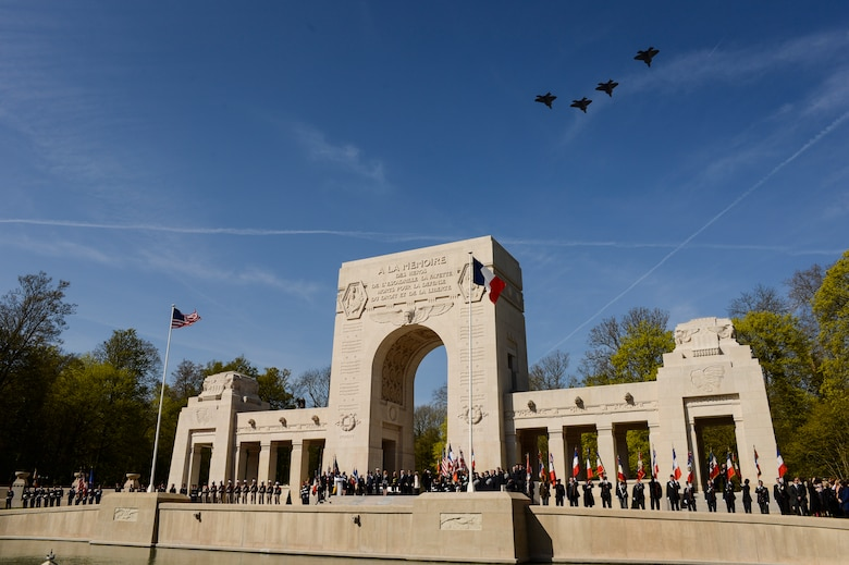 PARIS – Four U.S. Air Force F-22 Raptor fifth generation fighters fly over the Lafayette Escadrille Memorial in Marnes-la-Coquette, France, April 20, 2016, during a ceremony honoring the 268 Americans who joined the French Air Force before the U.S. officially engaged in World War I. In addition to the F-22s, a USAF B-52 Stratofortress bomber, three FAF Mirage 2000Ns, one FAF Rafale and a World War I-era Stearman PT-17 biplane performed flyovers during the ceremony commemorating the 100th anniversary of the Layfette Escadrille's formation. Men of the Lafayette Escadrille and Lafayette Flying Crops were critical to the formation of the U.S. Air Force. (U.S. Air Force Photo by Tech. Sgt. Joshua DeMotts/Released)