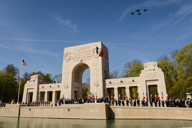 PARIS – Three French Air Force Mirage 2000Ns and one FAF Rafale fly over the Lafayette Escadrille Memorial in Marnes-la-Coquette, France, April 20, 2016, during a ceremony honoring the 268 Americans who joined the FAF during WWI. In addition to the Mirages and Rafale, four U.S. Air Force F-22 Raptor fifth generation fighters, a USAF B-52 Stratofortress bomber, and a World War I-era Stearman PT-17 biplane performed flyovers during the ceremony commemorating the 100th anniversary of the Layfette Escadrille's formation. Men of the Lafayette Escadrille and Lafayette Flying Crops were critical to the formation of the U.S. Air Force. (U.S. Air Force Photo by Tech. Sgt. Joshua DeMotts/Released)