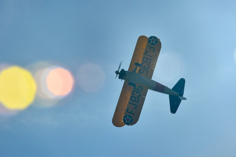 PARIS – A World War I-era Stearman PT-17 biplane flies over the Lafayette Escadrille Memorial in Marnes-la-Coquette, France, April 20, 2016, during a ceremony honoring the 268 Americans who joined the French Air Force before the U.S. officially engaged in World War I. In addition to the Stearman, four U.S. Air Force fifth generation F-22 Raptor fighters, a B-52 Stratofortress bomber, three FAF Mirage 2000Ns and one FAF Rafale performed flyovers during the ceremony commemorating the 100th anniversary of the Layfette Escadrille's formation. Men of the Lafayette Escadrille and Lafayette Flying Crops were critical to the formation of the USAF. (U.S. Air Force Photo by Tech. Sgt. Joshua DeMotts/Released)