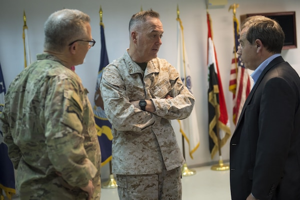 Marine Corps Gen. Joe Dunford, chairman of the Joint Chiefs of Staff, center, speaks to U.S. Ambassador to Iraq Stuart E.Jones, right, and Army Gen. Paul J. LaCamera, chief, Office of Security Cooperation - Iraq, after arriving in Baghdad, April 20, 2016. DoD photo by Navy Petty Officer 2nd Class Dominique A. Pineiro