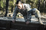 Army Reserve Spc. Kayla Bundy, a wheeled vehicle mechanic with the 1st Battalion, 414th Infantry Regiment, 95th Training Division, hurdles a wall on the fit-to-win endurance obstacle course during the 2016 108th Training Command Best Warrior competition at Fort Jackson, S.C., March 23, 2016. Bundy was selected to represent the 108th in the junior enlisted competition. Army photo by Sgt. 1st Class Brian Hamilton