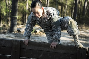 Spc. Kayla Bundy, 1st Bn., 414th Inf. Reg., 95th Training Division (IET), hurdles a wall on the fit-to-win endurance obstacle course during the 2016 108th Training Command (IET) Best Warrior competition held at Fort Jackson, S.C., March 21. This year's Best Warrior competition determined the top NCO and junior enlisted Soldier who will represent the 108th Training Command (IET) at the Army Reserve Drill Sgt. of the Year competition later this year at Fort Bragg, N.C. Bundy was selected to represent the 108th in the junior enlisted competition. (U.S. Army photo by Sgt. 1st Class Brian Hamilton/released)