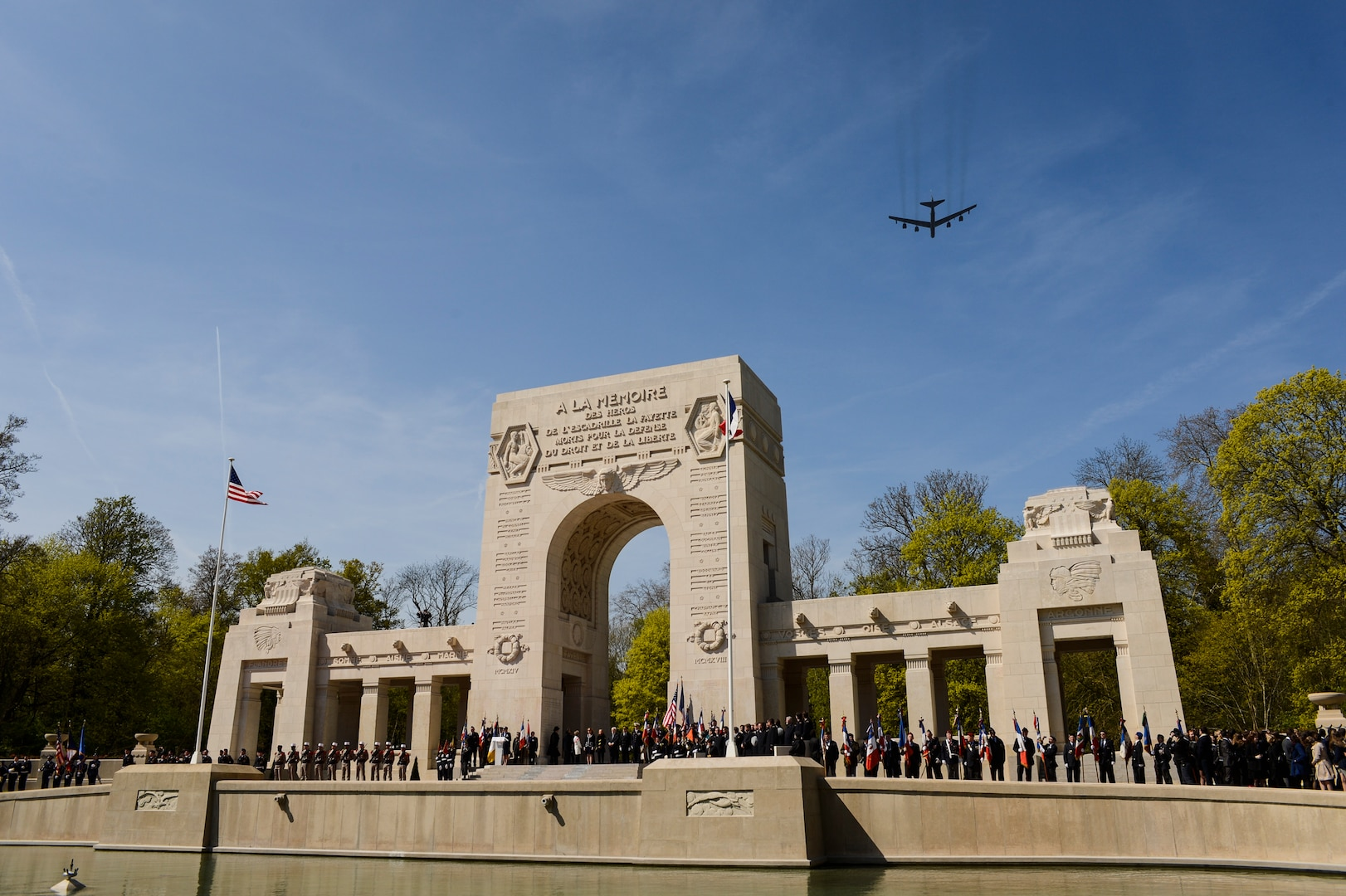 A U.S. Air Force B-52 Stratofortress strategic bomber from Minot Air Force Base, N.D., flies over the Lafayette Escadrille Memorial in Marnes-la-Coquette, France, April 20, 2016, during a ceremony honoring the 268 Americans who joined the French air force before the U.S. officially entered World War I. In addition to the B-52, four U.S. Air Force F-22 Raptors, four French air force Mirage 2000Ns and a World War I-era Steerman PT-17 biplane performed flyovers during the ceremony commemorating the 100th anniversary of the Lafayette Escadrille formation. The flight was part of long-range, B-52 sortie to train and integrate with the French Air Force. One of nine DoD unified combatant commands, USSTRATCOM has global strategic missions, assigned through the Unified Command Plan, which include strategic deterrence; space operations; cyberspace operations; joint electronic warfare; global strike; missile defense; intelligence, surveillance and reconnaissance; combating weapons of mass destruction; and analysis and targeting. (U.S. Air Force Photo by Tech. Sgt. Joshua DeMotts)