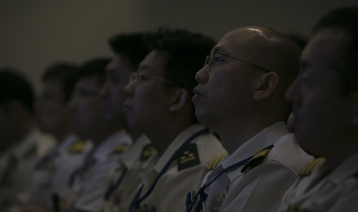 Japan Self-Defense Force service members, attending the Joint Staff College, received a presentation on the Marine Air-Ground Task Force and III Marine Expeditionary Force's chain of command during a visit to Camp Courtney, Okinawa, Japan on April 16, 2016. The presentation clarified the different sizes and capabilities of different MAGTFs and III MEF's capabilities in the Pacific. (U.S. Marine Corps photo by Cpl. William Hester/ Released)
