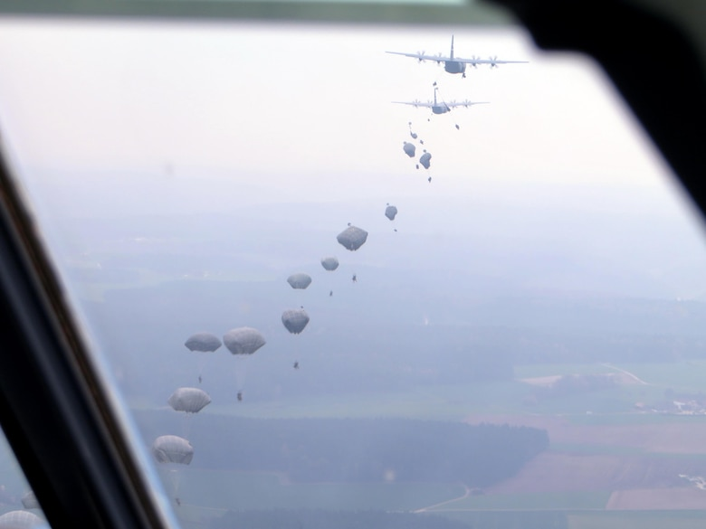C-130s release paratroopers from the U.S. Army 173rd Airborne Brigade over Hohenfels, Germany during exercise Saber Junction 16, April 12, 2016. The Air Force Reserve's 815th Airlift Squadron participated in the exercise April 5-20, 2016. (U.S. Air Force photo/Maj. Dave Hogue)