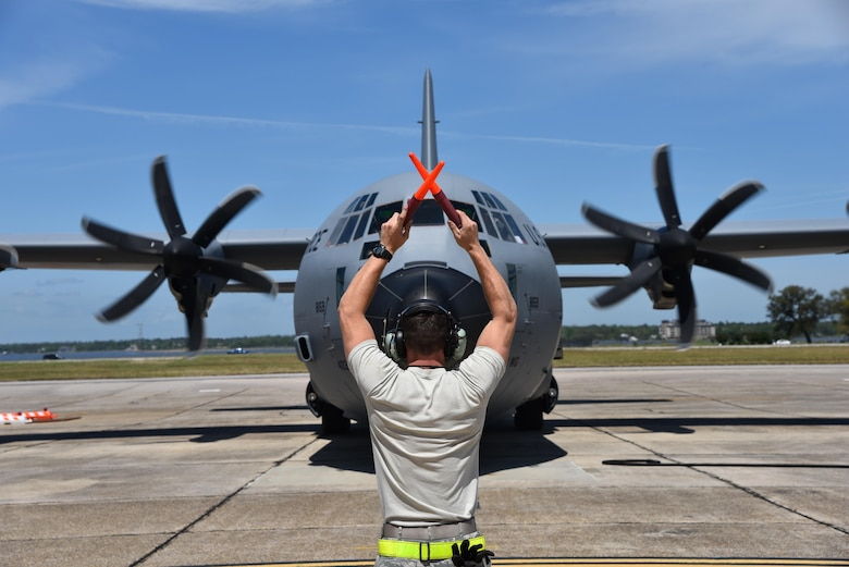 Senior Airman Christopher Townsley, 403rd Aircraft Maintenance Squadron crewchief at Keesler Air Force Base, Mississippi, marshalls in an 815th Airlift Squadron aircrew returning from Saber Junction 16, April 20, 2016. The exercise, which started March 31 and ends April 24, is the U.S. Army's annual combat training center certification exercise to evaluate the readiness of the 173rd Airborne Brigade. The 815th AS participated in the training event April 5-20, 2016. (U.S. Air Force/Maj. Marnee Losurdo)