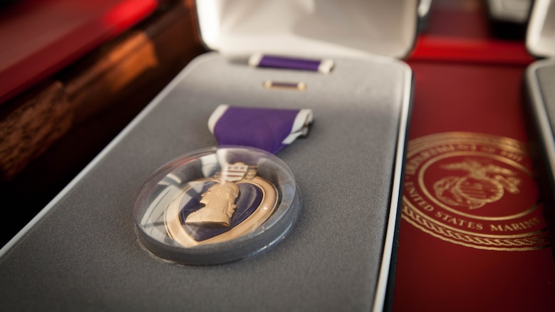 The families of Gunnery Sgt. Thomas J. Sullivan, Staff Sgt. David Wyatt, Sgt. Carson Holmquist, and Lance Cpl. Squire Wells, are presented the Purple Heart honoring the Marines sacrifice, at the Hunter Museum of American Art in Chattanooga, Tenn., April 20, 2016. The Marines were honored for giving their lives to protect others when they were attacked by a gunman at the Naval Operational Support Center and Marine Corps Reserve Center in Chattanooga on July 16, 2015.