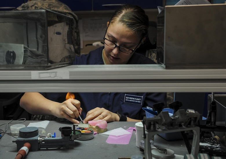 Staff Sgt. Kristina Plunkett, a dental laboratory technician with the 1st Special Operations Dental Squadron, cuts off excess material from a custom tray at Hurlburt Field, Fla., April 18, 2016. This four-manned laboratory cares for more than 40 patients every month. (U.S. Air Force photo by Senior Airman Meagan Schutter)