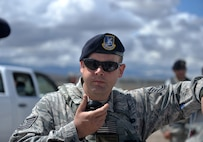 Tech. Sgt. Travis, 799th Security Forces member, coordinates with other security forces troops during a mass casualty exercise April 10, 2016, at Creech Air Force Base, Nevada. The 799th security forces protects and ensures the safety of Airmen who operate, support, and maintain the RPA operations. (U.S. Air Force photo taken by Airman 1st Class Kristan Campbell/Released)