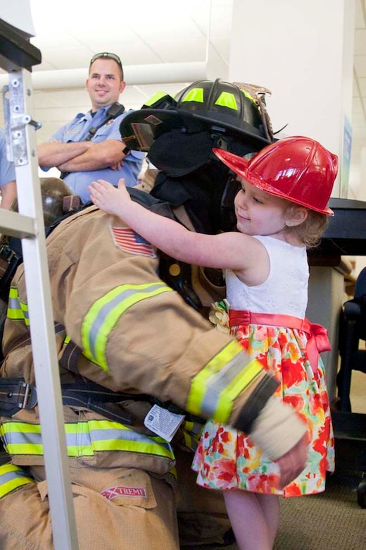 Lily, 3, attends a unique firefighter edition of story time.  Lily is the military child of an active duty Marine serving at The Basic School.