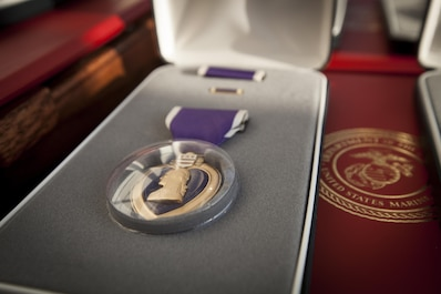 The families of Gunnery Sgt.  Thomas J. Sullivan, Staff Sgt. David Wyatt, Sgt. Carson Holmquist, Lance Cpl. Squire Wells, are presented the Purple Heart honoring the Marines sacrifice, at the Hunter Museum of American Art in Chattanooga, Tn., April 20, 2016. The Marines were honored for giving their lives to protect others when they were attacked by a gunman at the Naval Operational Support Center and Marine Corps Reserve Center in Chattanooga on July 16, 2015.(U.S. Marine Corps photo by MSgt. John Lee, II / Released)