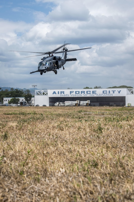 A U.S. Air Force HH-60G Pave Hawk helicopter, with the 33rd Rescue Squadron, Kadena Air Base, Japan, takes off from Clark Air Base, Philippines, April 19, 2016. The HH-60Gs flew in support of a newly stood up U.S. Pacific Command Air Contingent in the Indo-Asia-Pacific region. The Air Contingent will promote interoperability and provide greater and more transparent air and maritime situational awareness to ensure safety for military and civilian activities in international waters and airspace. This first deployment is conducting operations from Clark Air Base and consists of five A-10C Thunderbolt IIs, three HH-60G Pave Hawks and approximately 200 personnel deployed from multiple Pacific Air Forces units. (U.S. Air Force photo by Staff Sgt. Benjamin W. Stratton)