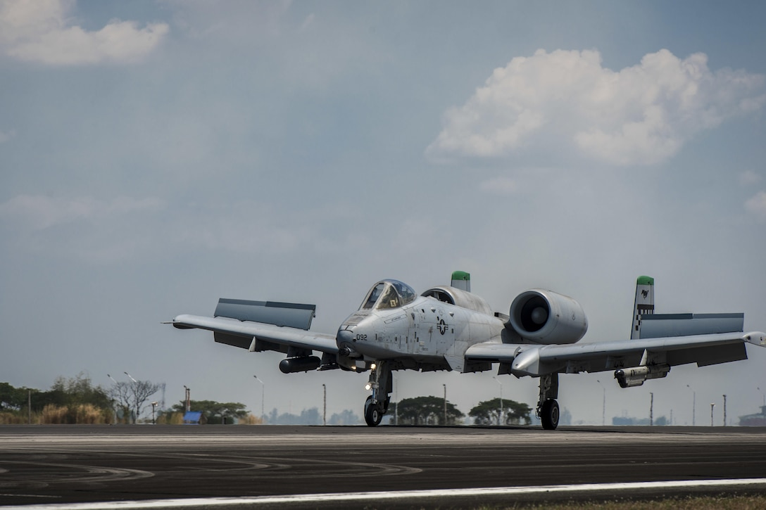 A U.S. Air Force A-10C Thunderbolt II, with the 51st Fighter Wing, Osan Air Base, Republic of Korea, touches down at Clark Air Base, Philippines, April 19, 2016, after returning from its first operational mission through international airspace providing air and maritime situational awareness. The A-10C's mission enhances U.S. military assets in the region upholding freedom of navigation and over flight. The five A-10Cs are joined with three HH-60G Pave Hawks and approximately 200 personnel deployed from multiple Pacific Air Forces units to make up the first iteration of the U.S. Pacific Command Air Contingent at Clark Air Base, Philippines. (U.S. Air Force photo by Staff Sgt. Benjamin W. Stratton)
