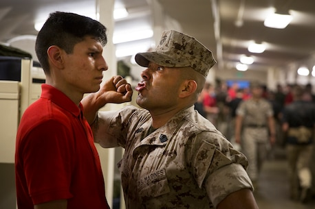 Gunnery Sgt. Agustin Juradosegovia (right), formerly a drill instructor at Marine Corps Recruit Depot San Diego, instructs an officer candidate to respond loudly to his commands during an Officer Candidates School preparation event at the Yakima Training Center in Yakima, Wash., April 8, 2016. During the three-day event, Marine Corps sergeant instructors and officer recruiters worked together to physically and mentally prepare candidates for the rigors of OCS, which the candidates are projected to attend aboard Marine Corps Base Quantico, Virginia. Juradosegovia is from Oxnard, Calif. (U.S. Marine Corps photo by Sgt. Reece Lodder)