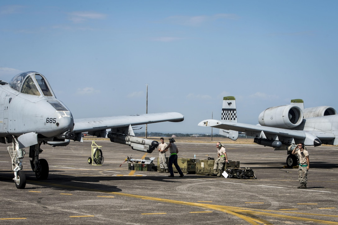 U.S. Air Force Senior Airman Daniel Mobili, a dedicated crew chief with the 51st Fighter Wing, Osan Air Base, Republic of Korea, salutes the pilot an A-10C Thunderbolt II after marshalling the aircraft for take off at Clark Air Base, Philippines, April 19, 2016. Maintenance Airmen play a critical role in the newly stood up Air Contingent's ongoing operations ranging from air and maritime domain awareness, personnel recovery, combating piracy, and assurance all nations have access to the regional air and maritime domains in accordance with international law. Mobili is a Miami, Florida, native. (U.S. Air Force photo by Staff Sgt. Benjamin W. Stratton)