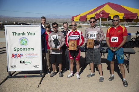 Winners of the Annual Earth Day Mountain Bike Ride held near Range 100 aboard the Combat Center proudly display their awards April 13, 2016. The eight-mile bike ride began and ended at Range 100. (Official Marine Corps photo by Cpl. Julio McGraw/Released)