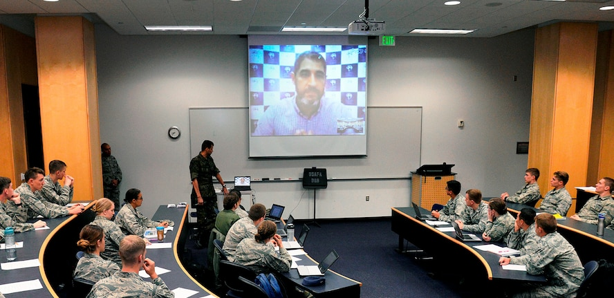 Marcelo Pedroso, the president of the Brazilian Olympic Public Authority, chats with Portuguese-language students at the U.S. Air Force Academy via video teleconference April 7. Pedroso spoke from his office in Rio de Janeiro and answered cadets' questions on how Rio will handle the massive undertaking of hosting the 2016 Olympic Games. (U.S. Air Force photo/Mike Kaplan)