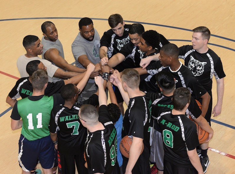 Team members from the 2nd Communications Squadron intramural basketball team huddle up prior to a game at Barksdale Air Force Base, La., April 14, 2016. The team completed the regular season with a 9-3 record and toppled an undefeated team and tournament favorite before eventually falling to the team from the 2nd Security Forces Squadron in the championship game. (U.S. Air Force photo/Airman 1st Class Curt Beach)