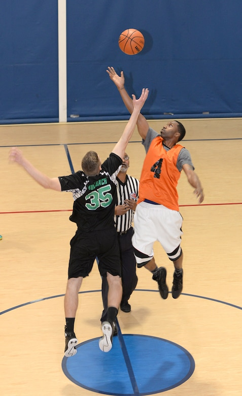 William Muhlbach, 2nd Communications Squadron center, and Josh Porter, 2nd Security Forces Squadron power forward, elevate for the opening tipoff of a championship basketball game at Barksdale Air Force base, La., April 14, 2016. The 2nd CS Tigers squared off against the 2nd SFS Bayou Warriors for the title of base intramural basketball champs. (U.S. Air Force photo/Airman 1st Class Curt Beach)