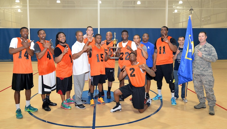 The 2nd Security Forces Squadron championship basketball team poses for a photo at Barksdale Air Force Base, La., April 14, 2016. The team defeated the 2nd Communications Squadron team in back-to-back games to win the championship by scores of 66-57 and 55-49. (U.S. Air Force photo/Airman 1st Class Curt Beach)