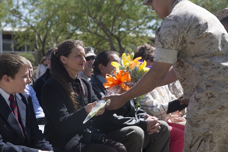 Katherine Kennedy, daughter of Col. Andrew R. Kennedy, former director of Tactical Training and Exercise Control Group, is presented flowers during her father's retirement ceremony at Lance Cpl. Torrey L. Gray Field April 15, 2016. (Official Marine Corps photo by Cpl. Medina Ayala-Lo/Released)