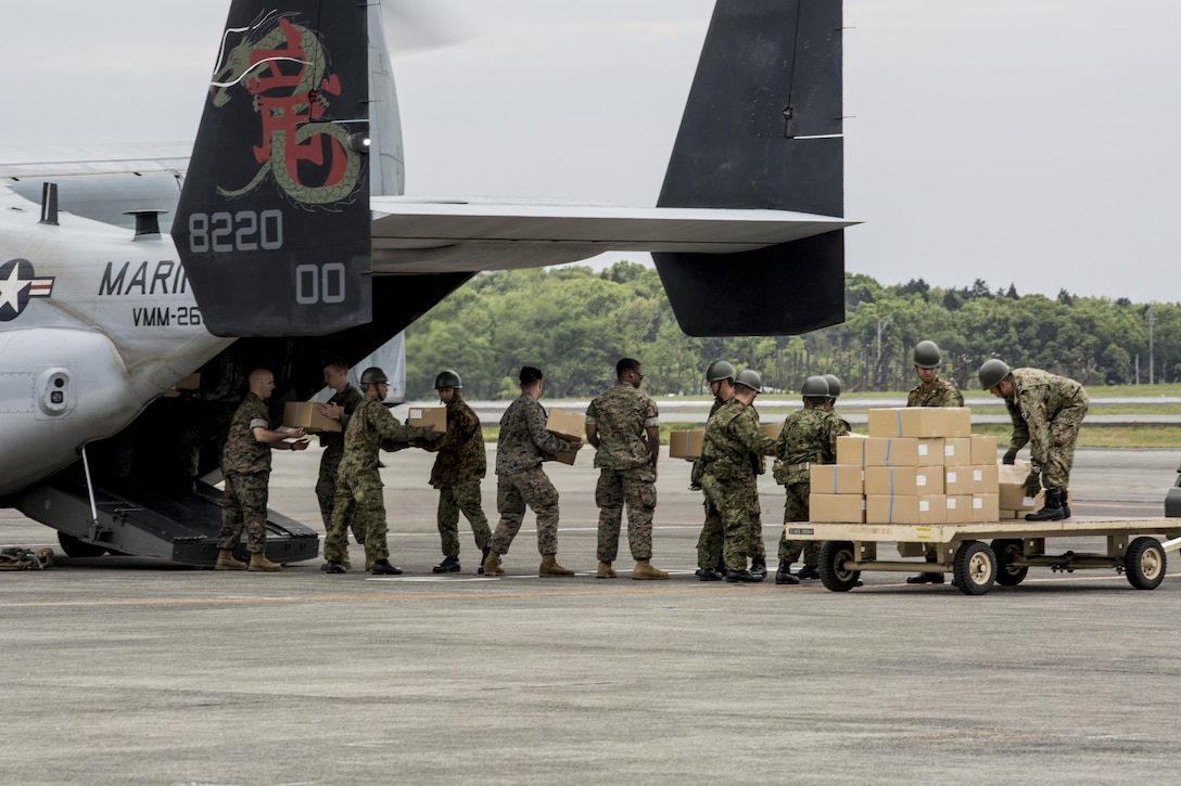 U.S. Marines and Japanese soldiers load boxes of humanitarian aid into an MV-22 Osprey aircraft at Japanese Camp Takayubaru, Japan, April 18, 2016, to support earthquake relief efforts near Kumamoto. (Marine Corps photo/Cpl. Nathan Wicks)