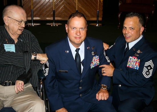 "Chief Master Sgt. Raymond Beyers, 2nd Special Operations Squadron, had his new chevrons ""tacked on"" by his father, retired Staff Sgt. J.J. Beyers, and Chief Master Sgt Matthew Caruso, Air Force Special Operations Command Command Chief during a promotion ceremony at Hurlburt Field, Florida, in April 2015.  J.J. Beyers, an Operation Eagle Claw survivor who served 17 years in the Air Force, passed away nearly a month after the ceremony.  (Courtesy photo)"