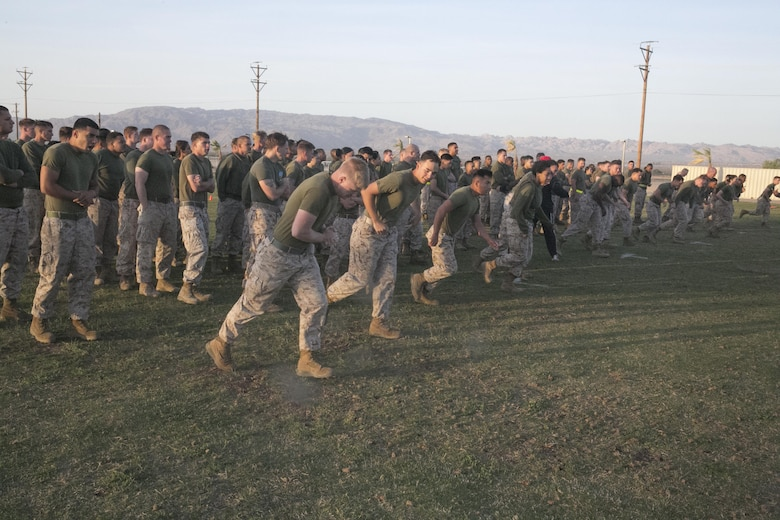 Marines with Headquarters Battalion begin their warm-ups during a High Intensity Tactical Training event held by Sgt. Maj. Avery Crespin, Headquarters Battalion Sergeant Major, and the HITT staff at Del Valle Field April 15, 2016. (Official Marine Corps photo by Cpl. Thomas Mudd/Released)