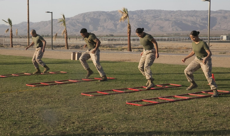 Sgt. Maj. Avery Crespin, Headquarters Battalion Sergeant Major, exercises with Headquarters Battalion Marines during a High Intensity Tactical Training event held by Crespin and the HITT staff at Del Valle Field April, 15, 2016. (Official Marine Corps photo by Cpl. Thomas Mudd/Released)
