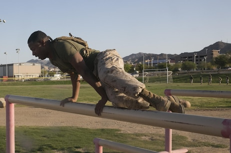 Cpl. Carlos Morris, staff driver, Headquarters Battalion, vaults over an obstacle during a High Intensity Tactical Training event held by Sgt. Maj. Avery Crespin, Headquarters Battalion Sergeant Major, and the HITT staff at Del Valle field April 15, 2016. (Official Marine Corps photo by Cpl. Thomas Mudd/Released)