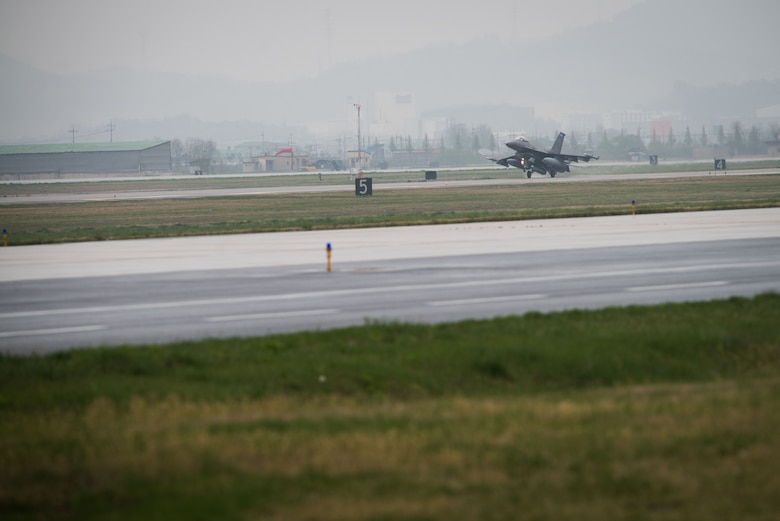 An F-16 Fighting Falcon from the 148th Fighter Wing taxis on the flightline after arriving to Osan Air Base, Republic of Korea, April 20, 2016. The 148th FW out of Duluth Air National Guard Base, Minnesota, deployed 12 F-16 aircraft to Osan as part of a theater security package to enhance regional security on the Korea Peninsula. The U.S. Air Force routinely deploys force packages of fighters throughout the Republic of Korea to demonstrate the U.S. commitment to stability on the Korea Peninsula. (U.S. Air Force photo by Senior Airman Dillian Bamman/Released)
