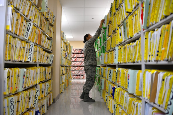Airman 1st Class Tatiana Soper, 60th Medical Support Squadron medical records technician, files records April 20 at Travis Air Force Base, California. The 60th MDSS is responsible for filing and storing more than 68,000 outpatient medical records. (U.S. Air Force photo by Senior Airman Amber Carter)