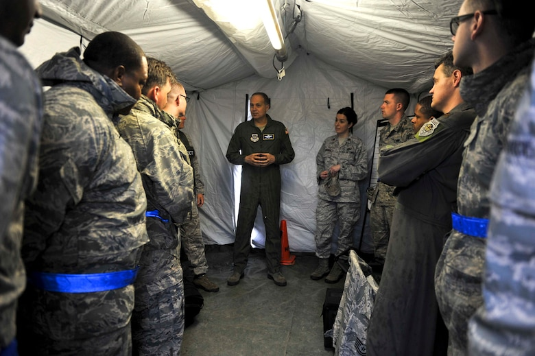 U.S. Air Force Maj. Gen. Jerry Martinez, Air Mobility Command Director of Operations, meets with Airfield Operations Airmen from McGuire Air Force base April 18, 2016, at Fort Polk, La., during Green Flag 16-06.  The Royal Australian Air Force, Royal New Zealand Air Force and U.S. Air Force train during Green Flag Little Rock to ensure all aircrew can effectively communicate. (U.S. Air Force photo by Staff Sgt. Jeremy McGuffin)