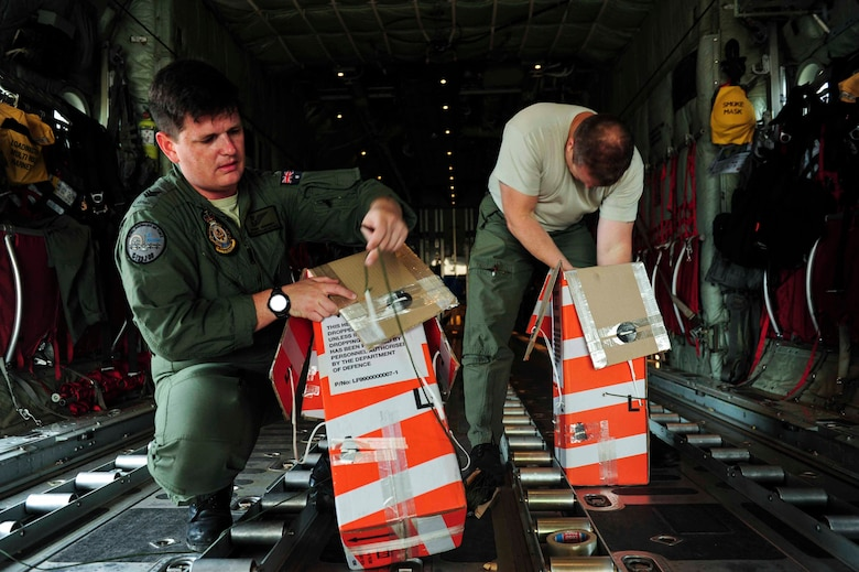 Royal Australian Air Force loadmasters, pack heliboxes to be dropped to troops April 18, 2016, at Little Rock Air Force Base, Ark. The RAAF, Royal New Zealand Air Force and U.S. Air Force train during Green Flag Little Rock to ensure all aircrew can effectively communicate. (U.S. Air Force photo by Senior Airman Kaylee Clark)