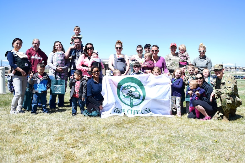 Parents and children from A-Basin Child Development Center gather together during an Earth and Arbor Day celebration April 21, 2016, on Buckley Air Force Base, Colo. Trees isolate carbon that would otherwise end up in the atmosphere, warming Earth, and provides shade that lowers the need for air conditioning. (U.S. Air Force photo by Senior Airman Racheal E. Watson/Released)