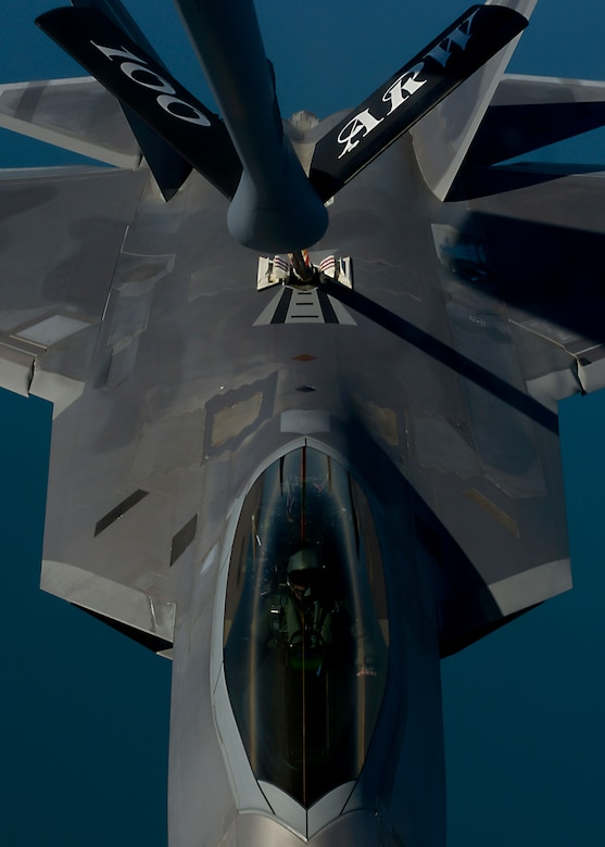 A U.S. Air Force KC-135 Stratotanker assigned to RAF Mildenhall, England, refuels an F-22 Raptor from the 95th Fighter Squadron at Tyndall Air Force Base, Fla., while participating in exercise Iron Hand April 19, 2016, over the Norfolk Sea. The F-22s conducted multiple air training exercises with 48th Fighter Wing F-15s assigned to RAF Lakenheath, as well as other U.S. and Royal Air Force aircraft throughout the exercise. (U.S. Air Force photo by Senior Airman Victoria H. Taylor/Released)