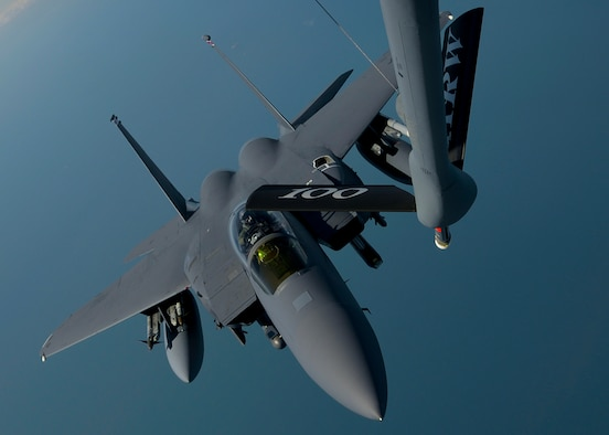 A U.S. Air Force 48th Fighter Wing F-15 Strike Eagle from RAF Lakenheath, England, approaches the boom of a 100th Air Refueling Wing KC-135 Stratotanker assigned to RAF Mildenhall, England April 19, 2016, over the Norfolk Sea. The 48th FW participated in air training drills alongside U.S.A.F. F-22s and other Europe-based aircraft in support of exercise Iron Hand. (U.S. Air Force photo by Senior Airman Victoria H. Taylor/Released)