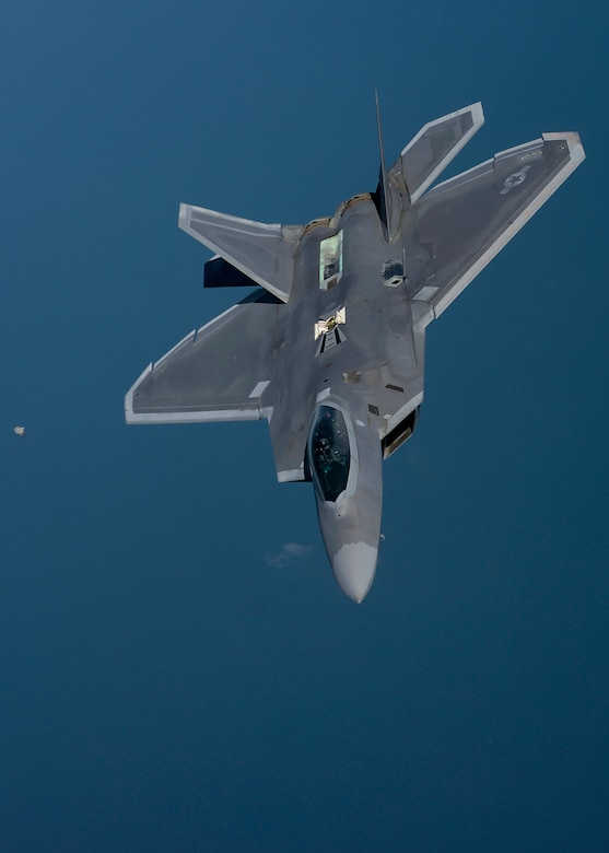 An F-22 Raptor assigned to the 95th Fighter Squadron at Tyndall Air Force Base, Fla., flies over the Norfolk Sea April 19, 2016, while participating in Exercise Iron Hand. The fifth generation, multi-role fighter aircraft participated to maximize training opportunities, affirm enduring commitments to NATO allies, and deter any actions that destabilize regional security. (U.S. Air Force photo by Senior Airman Victoria H. Taylor/Released)
