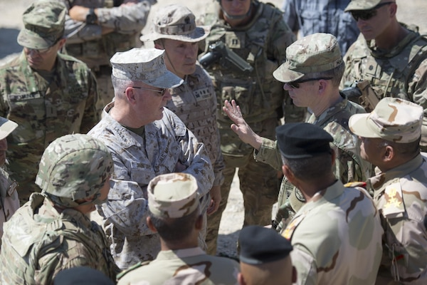 Marine Corps Gen. Joe Dunford, center left, chairman of the Joint Chiefs of Staff, speaks with Army Lt. Gen. Sean MacFarland, commander of Combined Joint Task Force Operation Inherent Resolve, at Besmaya Range Complex in Iraq, April 21, 2016. Dunford is visiting Iraq to assess the campaign against the Islamic State of Iraq and the Levant. DoD photo by Navy Petty Officer 2nd Class Dominique A. Pineiro