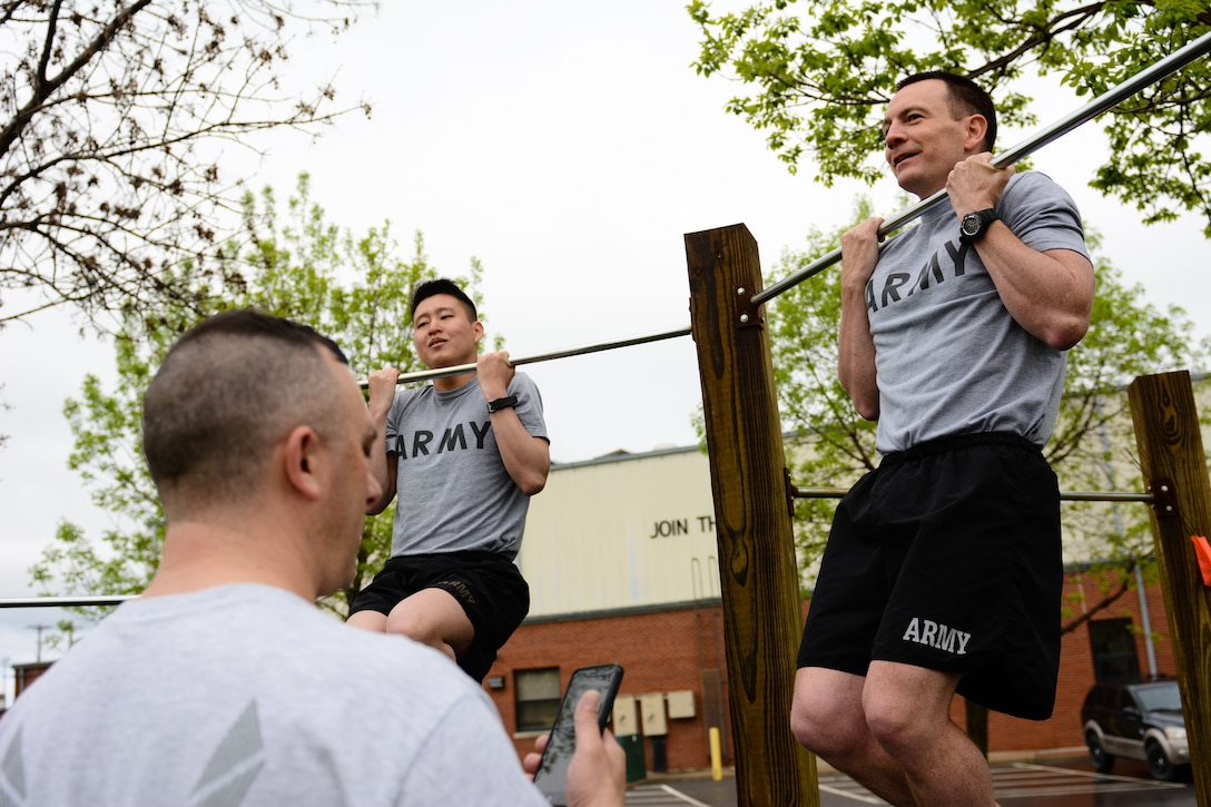 U.S. airmen assigned to the 139th Airlift Wing, Missouri Air National Guard, perform pull-up hangs during a German Armed Forces Badge for Military Proficiency test at Rosecrans Air National Guard Base, St. Joseph, Mo., April 20, 2016. Airmen and soldiers qualify in various events including running, swimming, sprints, pull-up hang, pistol marksmanship, and a ruck march. Participates may qualify in bronze, silver, or gold categories. (U.S. Air National Guard photo by Senior Airman Bruce Jenkins/released)