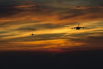Two C-17 Globemaster IIIs from the 437th Airlift Wing prepare to drop Soldiers from the 82nd Airborne Division at Fort Bragg, N.C., April 15, 2016. The mass tactical exercise helped prepare both units for any future real-world scenarios they may face. (U.S. Air Force photo/Senior Airman Taylor Queen)