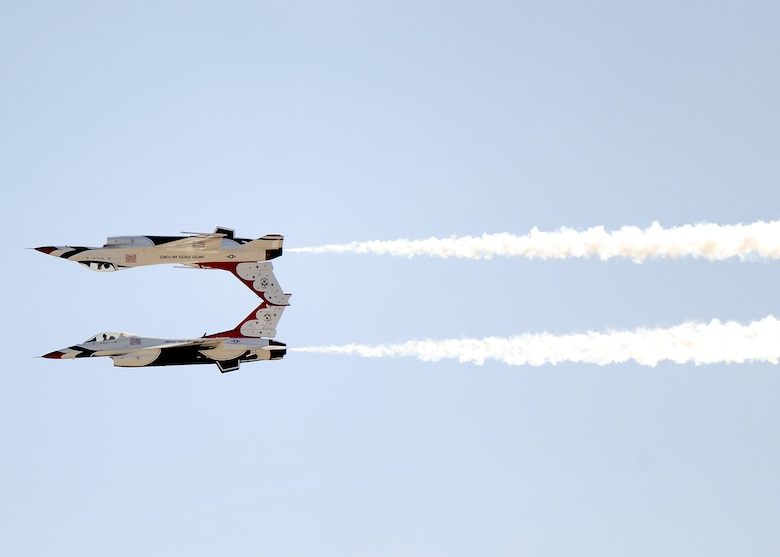 A pair of F-16 Fighting Falcons performs maneuvers as part of the Thunderbirds show during the March Field Airfest in California, April 16, 2016. The Airfest features military and civilian aerial and ground demonstrations during a two-day air show. (U.S. Air Force photo/Tech Sgt. Stephen D. Schester)