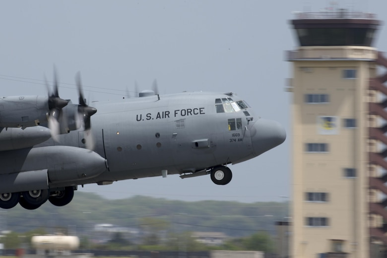 A C-130 Hercules takes off from Yokota Air Base, Japan, April 18, 2016. The 374th Airlift Wing sent two aircraft to support the Japanese government in their relief efforts for the series of earthquakes that recently took place in the Kyushu region. The aircraft transported heavy vehicles and personnel from Chitose Air Base, Hokkaido, to Kyushu. (U.S. Air Force photo/Yasuo Osakabe)