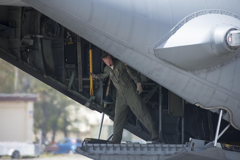 A loadmaster from the 36th Airlift Squadron checks a C-130 Hercules at Yokota Air Base, Japan, April 18, 2016. The 374th Airlift Wing sent two aircraft to support the Japanese government in their relief efforts for the series of earthquakes that recently took place in the Kyushu region. The aircraft transported heavy vehicles and personnel from Chitose Air Base, Hokkaido, to Kyushu. (U.S. Air Force photo/Yasuo Osakabe)