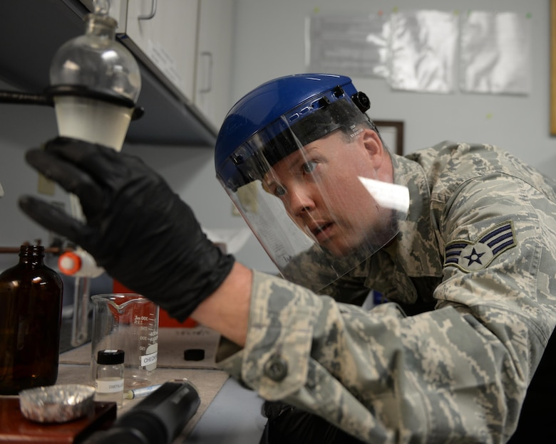 Senior Airman Timothy D. Burrows, a 157th Logistics Readiness Squadron fuels labs technician, performs a quality control test on jet aircraft fuel at Pease Air National Guard Base, N.H., April 21, 2016. (U.S. Air  National Guard photo/Staff Sgt. Curtis J. Lenz)