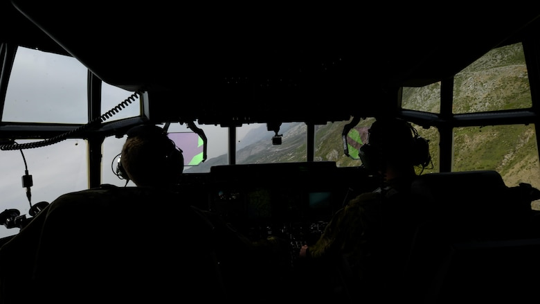U.S. Air Force pilots aboard an MC-130J Commando II assigned to the 67th Special Operations Squadron conducted low-level operations during an exercise April 13, 2016, over Albania. The aircraft was one of two MC-130Js that conducted unilateral formation low-level operations as a part of a multi-operation training deployment. (U.S. Air Force photo by Senior Airman Victoria H. Taylor/Released)